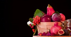 Still life red fruits rotation 4k loop video intro copy space black background Stock Footage
