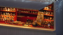 Christmas market stall displaying wooden decorations Stock Footage