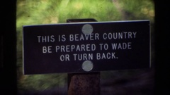 1980: an advertisement states that you are in beaver territory and that you must Stock Footage