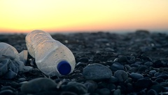 Garbage at beach: plastic bag and plastic bottle Stock Footage