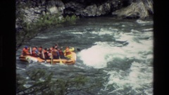 1980: people rafting down some rapids in a canyon GRAND TETON WYOMING Stock Footage