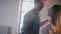 Couple in love is learning to dance in the studio Stock Footage