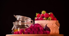 Still life fruits berry rotation 4k loop intro video Red basket black background Stock Footage