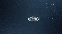 Zoom out of a Commercial Ship Fishing with Trawl Net on the Sea. Stock Footage