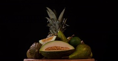 Still life green fruits rotation 4k loop video copy space intro black background Stock Footage