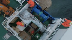 Zoom Out of a Commercial Fishing Ship where People processing the Fish. Top down Arkistovideo