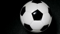 Soccer ball or football bright studio on a black background Stock Footage