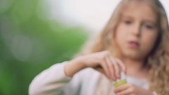 Girl with soap bubbles outdoors Stock Footage