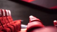 Empty red seats of cinema, theater interior scene Stock Footage