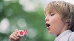 Smiling boy with soap bubbles Stock Footage