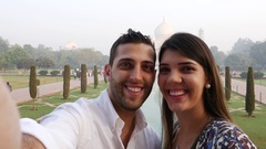 Couple taking a selfie in Taj Mahal, Agra, India Stock Footage