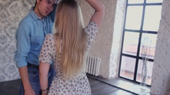 Young couple in love is learning the dance studio Stock Footage