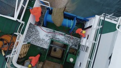 Flying Over a Commercial Fishing Ship where People processing the Fish. Top down Stock Footage