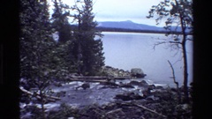 1980: creek flowing into a lake with mountains in the background GRAND TETON Stock Footage