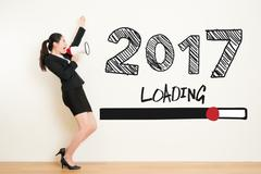 Business woman shout with loud megaphone with 2017 Stock Photos