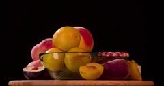 Still life peach plum fruits jam rotation 4k loop video intro copy space Stock Footage