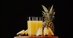 Still life pineapple juice fruits rotation 4k loop intro video copy space Stock Footage