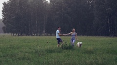 Beautiful young fun in a forest glade with his dog Stock Footage