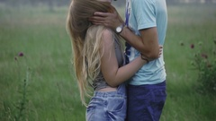 Young couple kissing in a forest glade Stock Footage