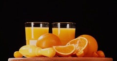 Still life citrus orange juice fruits rotation 4k looped video intro copy space Stock Footage
