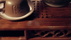 Tilt shot of clay cups and tea pot on chaban. Stock Footage