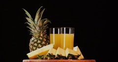 Still life pineapple juice fruits rotation 4k looped intro video copy space Stock Footage