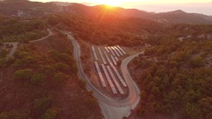 Aerial of a Solar Park in sunset. 4K Video of power generation with solar cells Stock Footage