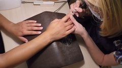 Master makes a manicure in salon Stock Footage