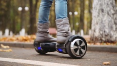 Smiling little girl riding on gyroscooter Stock Footage