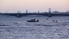 Water patrol have conversation with PWC riders, dusk Neva River view Stock Footage