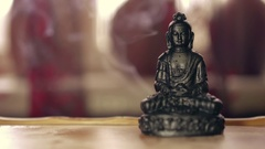 Buddha figure on wooden tea board (chaban) with an aroma smoke Stock Footage