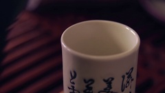 The action of traditional Chinese tea ceremony. Close up of pouring tea Stock Footage