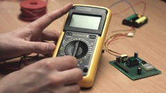 Plug in probes in digital multimeter Stock Footage