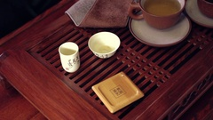 The action of traditional Chinese tea ceremony. Pouring tea in a cup Stock Footage