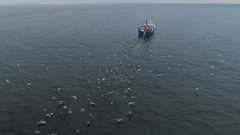 Flying towards a Commercial Fishing Ship that Pulls Trawl Net Stock Footage