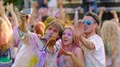 Joyful friends waving hands and dancing, posing for phone camera at festival HD Footage
