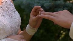 Gentle bride wears the groom's ring. Wedding ceremony. Stock Footage