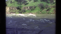 1982: waves crashing through rapids adjacent to the dam on a river. SACRAMENTO Stock Footage