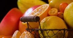 Still life fruits citrus rotation 4k loop video intro. Orange black background Stock Footage