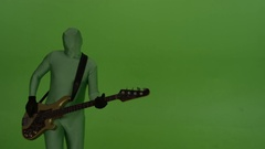 Guitar player on chroma key background, dressed in a greenscreen suit. Stock Footage