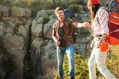 Adventure couple walking on rocks Stock Photos