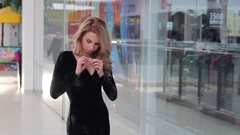 Beautiful girl in a cosmetics store and furniture Stock Footage