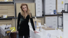 Beautiful girl in a furniture store Stock Footage