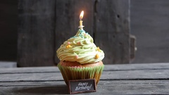 Happy Birthday text and cake with one candle Stock Footage