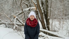 Young girl in white knitted hat, red scarf and mittens Stock Footage