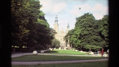 1982: a slowly zooming view of a large building from the front gardens, flanked Stock Footage