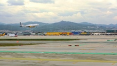 BARCELONA, SPAIN, APRIL 30, 2016: White Plane Landing On Airport Runway Stock Footage