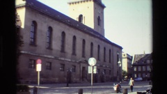 1982: tall old brick church with a tower and a cross on it DENMARK Stock Footage
