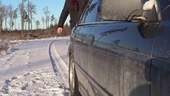Man with car window washing fluid walking near car Stock Footage