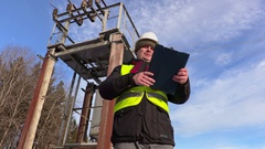 Electrician engineer talking near transformer Stock Footage